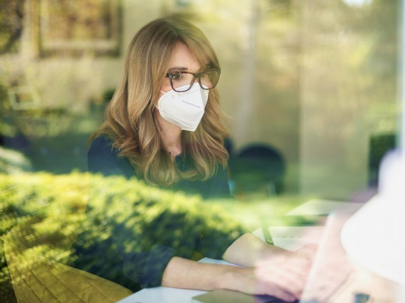 Female-business owner working during Covid-19 pandemic