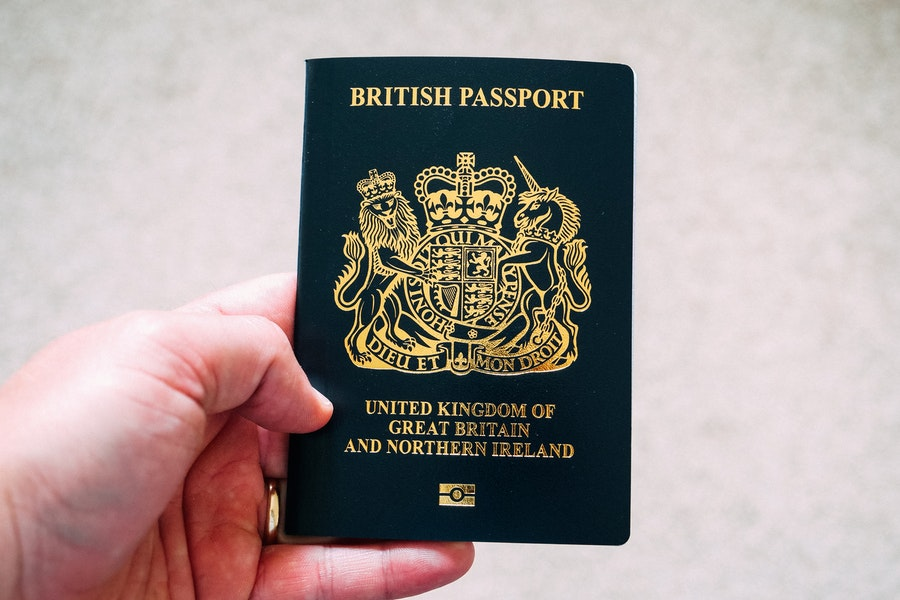 Man holding the new British Passport