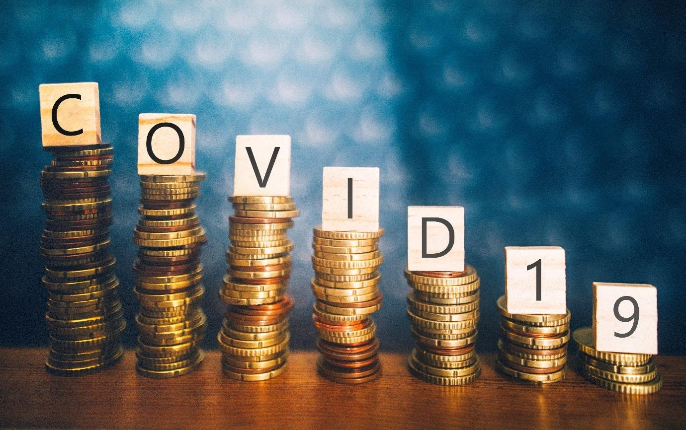 Pile of coins with COVID letters over