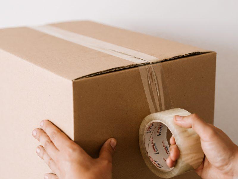 Man sealing a cardboard box