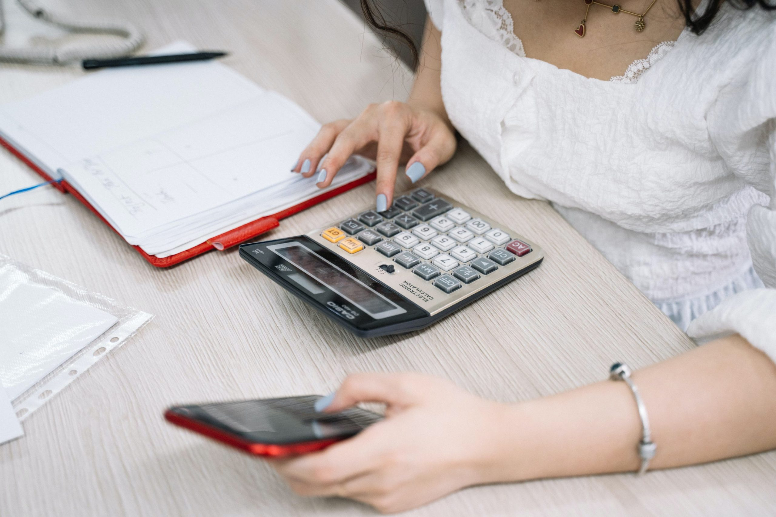 Women with a calculator and phone