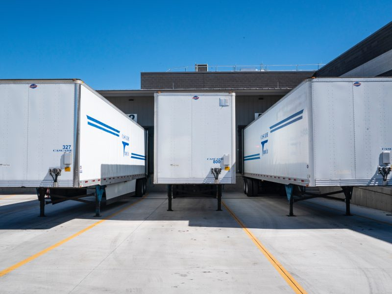 Three lorry trailer parked up